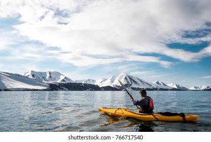 Sea kayaking in fjords of Kamchatka winter