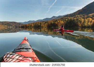 Sea kayaking on a calm lake