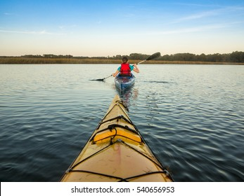 Sea kayaking, view of kayaker from first boat