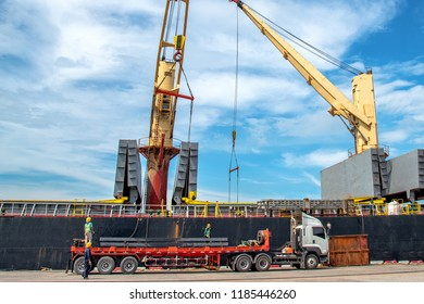 sea and land transportation meet together in the port terminal, loading and discharging cargo shipment under logistics system services to worldwide international