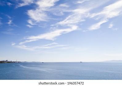 Sea landscape in beams of the bright summer sun