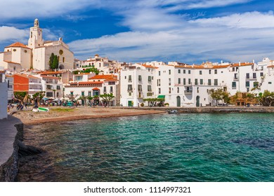 Sea landscape with Cadaques, Catalonia, Spain near of Barcelona. Scenic old town with nice beach and clear blue water in bay. Famous tourist destination in Costa Brava with Salvador Dali landmark