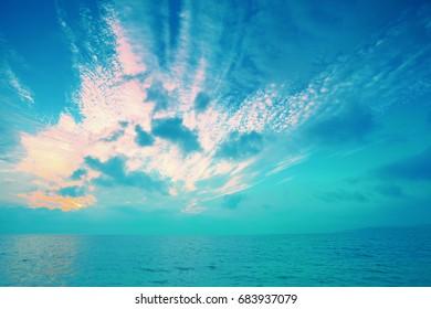Sea landscape. Early morning. Sunrise over sea. Sea shore with beautiful picturesque sky