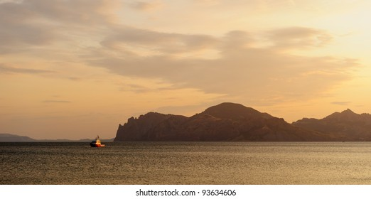 Sea landscape. An evening, the colourful sky