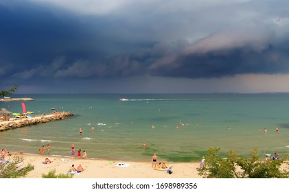 Sea landscape overlooking the beach and storm clouds on the horizon