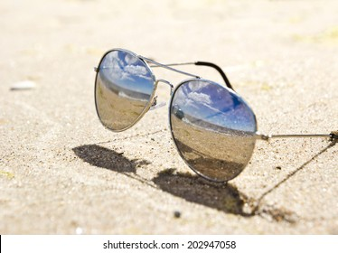 sea landscape reflecting in the sunglasses on the beach