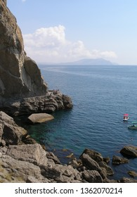 Sea landscape with a rock and a rest. Black Sea coast. Crimea. New light. Golitsinna trail