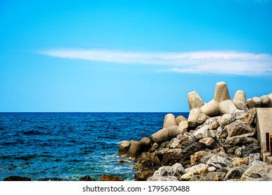Sea landscape with rocks and concrete tetrapods for coastal protection from breakwaters  - Shutterstock ID 1795670488