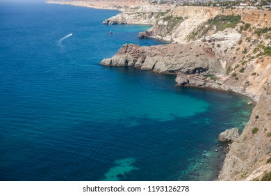 Sea landscape with rocks and turquoise water near Sevastopol on the Black Sea in the Crimea