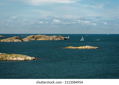 Sea landscape of a rocky coastline on the South of Sweden. Southern coastline of Sweden with view at rocky islands and white yachts.