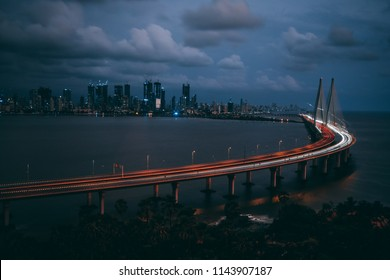 The Bandra–Worli Sea Link is a cable-stayed bridge with pre-stressed concrete-steel viaducts on either side that links Bandra in the Western Suburbs of Mumbai with Worli in South Mumbai.
