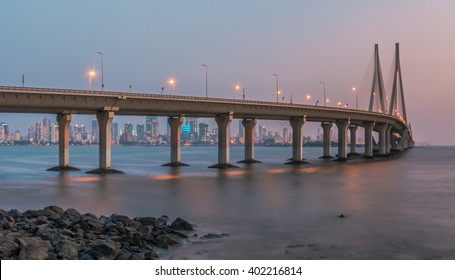 Sea Link in Mumbai, India during evening twilight (Slow shutter speed to create motion on water. Image has been cropped intentionally to create a slightly panoramic effect)
