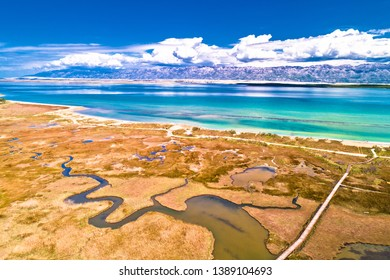 Sea marshes and shallow sand beach of Nin aerial view, Velebit mountain background, Dalmatia region of Croatia