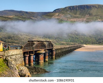 Sea mist rolls in at the Barmouth pedestrian and railway bridge, the longest viaduct in Wales, UK. Situated over the River Mawddach at Barmouth. Used by cyclists too.