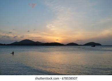 Sea with mountain and beautiful sunrise background