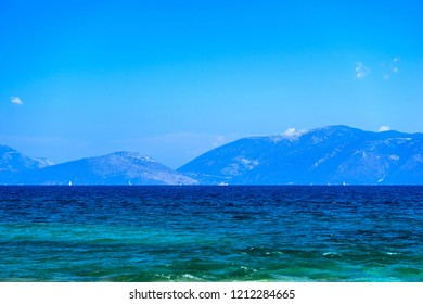 sea mountain landscape with hilly coast on the horizon and with the clear blue sky for a natural background