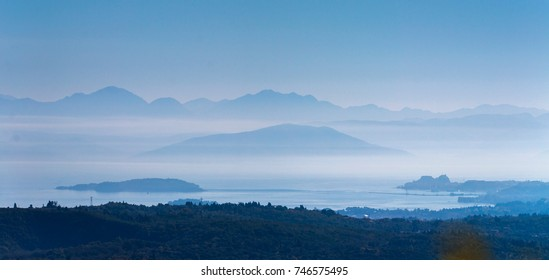 Sea and mountains in mist. Corfu island, Greece.
