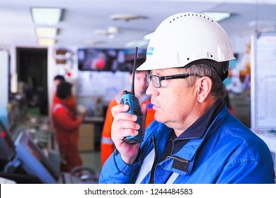Sea of Okhotsk near Sakhalin, Russia - July 26, 2017: The company's worker at the workplace speaks on the radio.