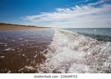 sea wave on white sand