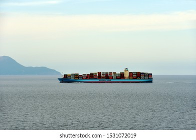 At sea / Pacific Ocean September 28 2019: Large container ship, owned by Maersk Line, fully loaded with the colorful containers, sailing through the Pacific Ocean near Japanese island Hokkaido.