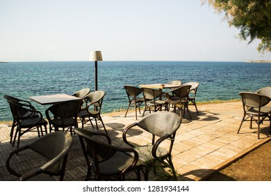 sea patio restaurant cafe park outdoor space on sea shoreline waterfront district, summer tropic island vacation concept photography