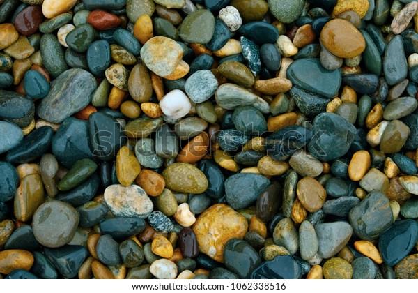 Sea pebble and sea stones beach rocks background