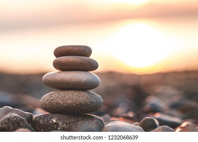 Sea pebbles on the beach at sunset. Wallpaper, background. Balance, harmony and meditation concept. Copy space