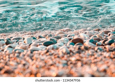 sea pebbles on the beach with waves closeup