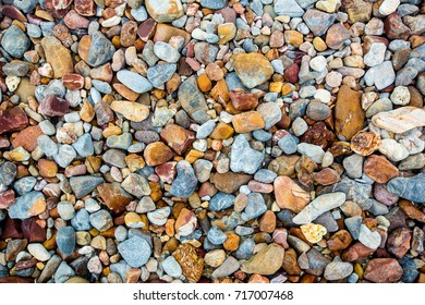 Sea pebbles. Small stones gravel texture background.Pile of pebbles, thailand.Color stone in background.background of round colored sea pebbles.