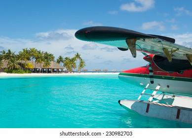 Sea plane at tropical beach resort