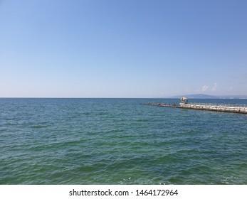 sea with pontoon in the sea blue sky