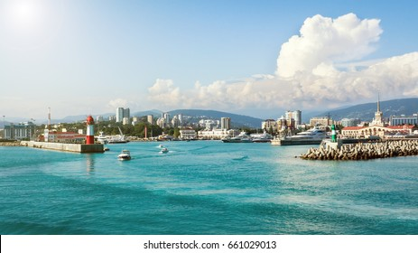 Sea port, boats and yachts at the pier in Sochi, Russia. Black Sea wide landscape.