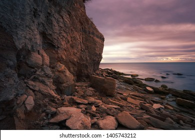 sea rock coast at evening sunlight, awesome nature sunset, cliff and stones  on background water and sky, scenic outdoor summer seascape, Europe, Italy, apulia,  travel, long exposure image