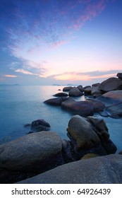 Sea and rock at the sunset. Nature composition under long exposure.