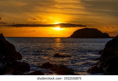 Sea rock sunset water horizon. Sea sunset horizon landscape. Sea sunset landscape. Sunset sea horizon landscape - Shutterstock ID 1922550875