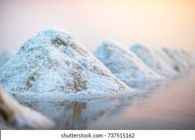 Sea salt evaporation pond in Petchaburi, Thailand. Closeup of sea salt pile pyramid. Sea salt farming concept.