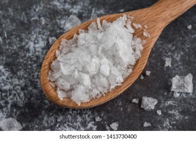 Sea Salt Flakes Spilled from a Teaspoon