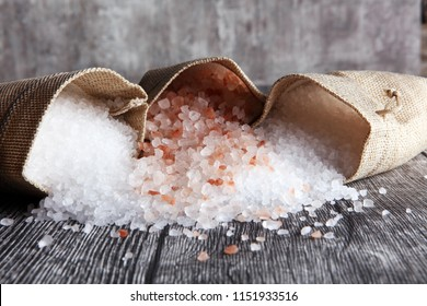sea salt and himalayan in burlap. Crystals of salt on table
