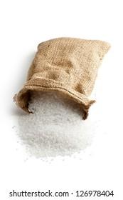 sea salt in jute sack on white background