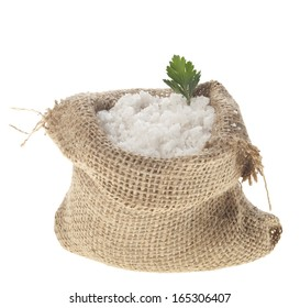 Sea salt in a jute sack on a white background.