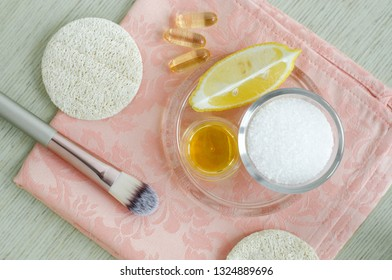 Sea salt, olive oil, lemon and vitamin E softgels - ingredients for preparing diy face and hair masks, scrubs and moisturizers. Homemade beauty treatments recipe. Top view, copy space