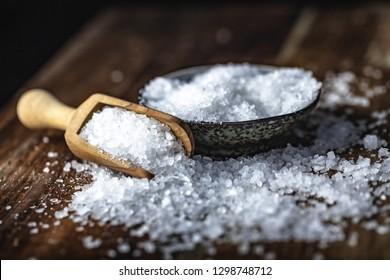 sea salt on a dark beautiful wooden background