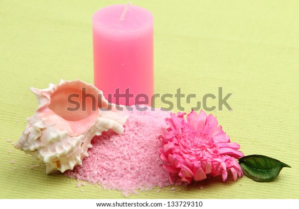 Sea salt and pink candles and sea shell composition on the theme of rest and relaxation