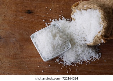 Sea salt in sack bag on wooden