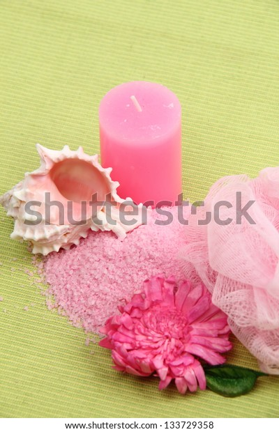 Sea salt, sea shell and pink candle composition on the theme of rest and relaxation
