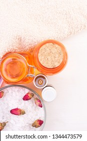 Sea salt, towel, essential oils and other bath cosmetic and Accessories on the wooden background