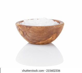 sea salt in wooden bowl for cooking or spa, isolated