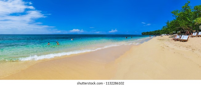 The sea and sand at Bamboo Beach in Jamaica at sunny day