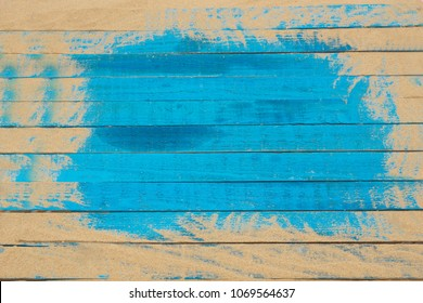Sea sand on blue wooden floor ,Top view with copy space, summer concept