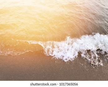 Sea sand and sun . The beach with sunshine filter. Sea foam.